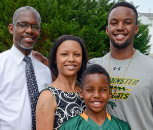 Chris Parker, younger brother, Xavier, 9, along with his mother, Jennifer and stepfather, Javoke Terrell.