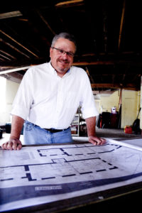 Scott Jendrek stands in what will be the tasting room of his Patapsco Distillery.