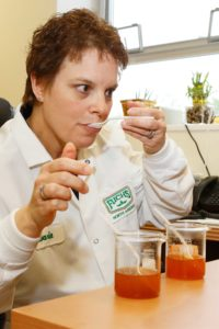 Senior Food Scientist, Darla Byerly, compares seasoning blends in the research lab.