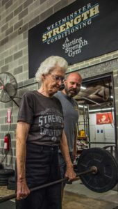 Darthean Fox of Westminster works out with her strength coach Beau Bryant as she goes through her weight training at Crossfit Retribution in Westminster.
