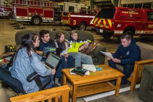 Young EMT volunteers Cheyenne Philipps, Vincent Alasha, Carly Smith, Josh Swain and Gunnar Mohlrenrich wait for another emergency call at the Westminster Fire Station.