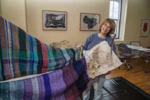 "Union Bridge artist Jo Israelson displays some of the weavings to make a symbolic tent for her recent exhibit, ""Welcoming the Stranger"", in the JewishMuseum of Maine."
